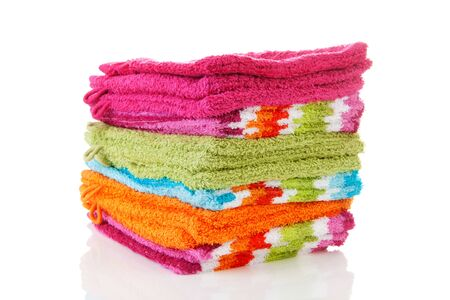 Pile of colorful washclothes over white background