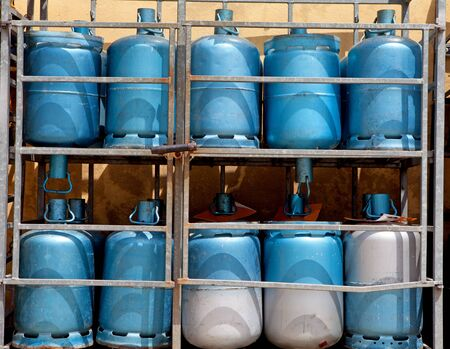 Storage with blue bottles of gas photo