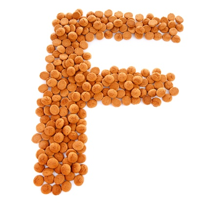 Ginger nuts, pepernoten, in the shape of letter F isolated on white background. Typical Dutch candy for Sinterklaas event in december Stock Photo - 16464678