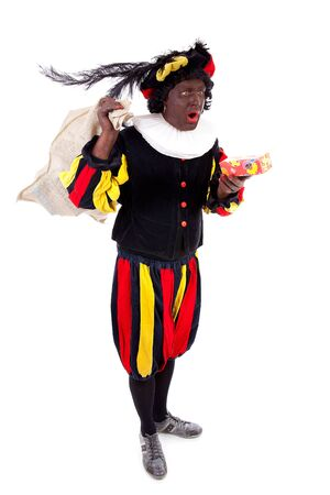 Zwarte piet ( black pete) typical Dutch character part of a traditional event celebrating the birthday of Sinterklaas in december over white background with present Stock Photo - 16591491