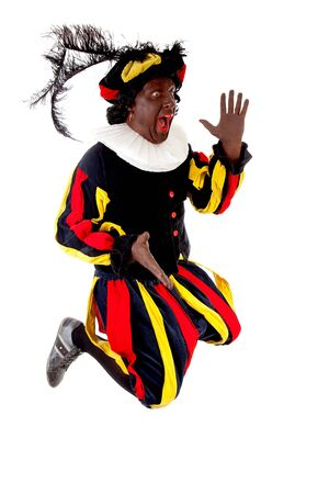 Excited jumping Zwarte piet ( black pete) typical Dutch character part of a traditional event celebrating the birthday of Sinterklaas in december over white background  Stock Photo - 16591479