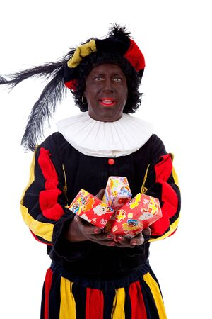 Zwarte piet ( black pete) typical Dutch character part of a traditional event celebrating the birthday of Sinterklaas in december over white background with presents photo