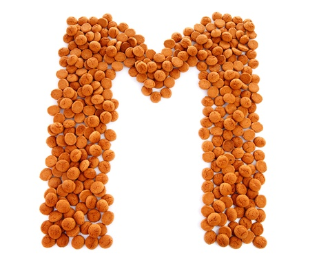 Ginger nuts, pepernoten, in the shape of letter M isolated on white background. Typical Dutch candy for Sinterklaas event in december Stock Photo - 16464700