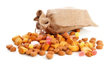 Bag with typical dutch sweets: pepernoten (ginger nuts) for Sinterklaas; celebration at 5 december in the Netherlands Stock Photo - 16464701