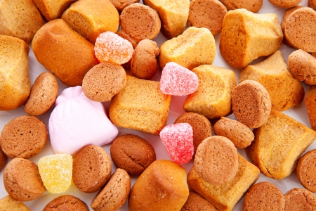 Typical dutch sweets: pepernoten (ginger nuts) for Sinterklaas; celebration at 5 december in the Netherlands in closeup Stock Photo