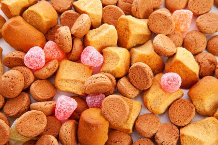 Typical dutch sweets: pepernoten (ginger nuts) for Sinterklaas; celebration at 5 december in the Netherlands in closeup Stock Photo - 16464712