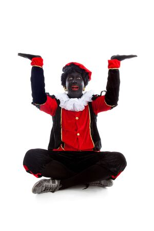 Zwarte piet ( black pete) typical Dutch character part of a traditional event celebrating the birthday of Sinterklaas in december over white background with hands up Stock Photo - 16591476