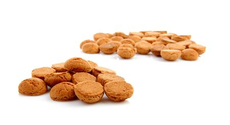 pile of ginger nuts, pepernoten isolated on white background. Typical Dutch candy for Sinterklaas event in december Stock Photo - 17807208