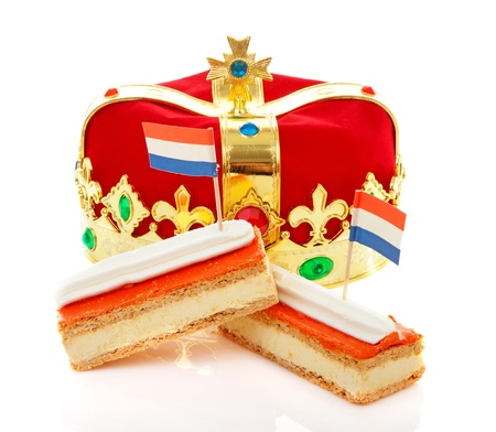 Typical Dutch tompouce sweet with crown over white background Standard-Bild