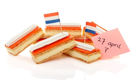 Pile of traditional Dutch pastry called tompouce with flags over white background Stock Photo - 20008569
