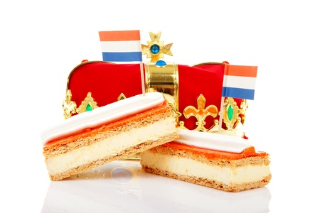 happening: Typical Dutch tompouce sweet with crown over white background Stock Photo