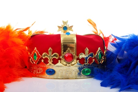 happening: Crown and feathers in Dutch flag for Kingsday over white background Stock Photo