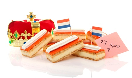 beatrix: Typical Dutch tompouce sweet with crown over white background Stock Photo