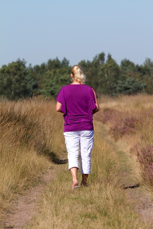 Woman is walking, view from the back photo