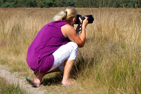Woman is taking a photograph photo