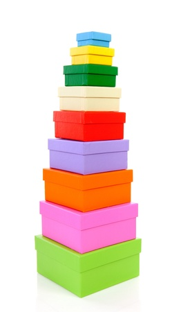 stacked colorful packaging boxes isolated on white background Stock Photo