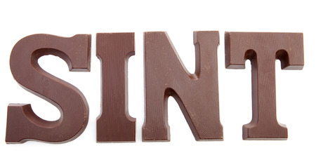 The word SINT in chocolate letters isolated on white background, typical Dutch candy for Sinterklaas event in december Stock Photo