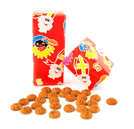 Ginger nuts and gifts for Dutch event in december over white background