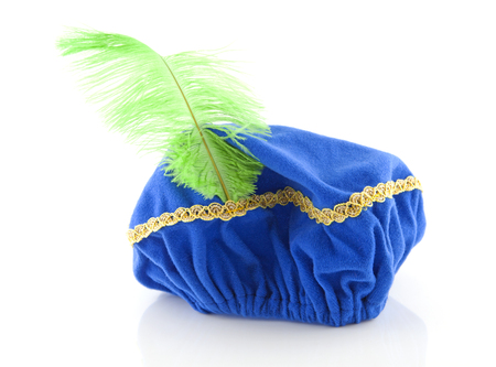 zwarte: Blue hat with green feather of Zwarte Piet isolated on white background Stock Photo