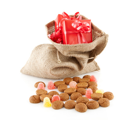 Typical Dutch celebration  Sinterklaas with surprises in jute bag and ginger nuts, ready for the kids in december  Isolated on white background photo