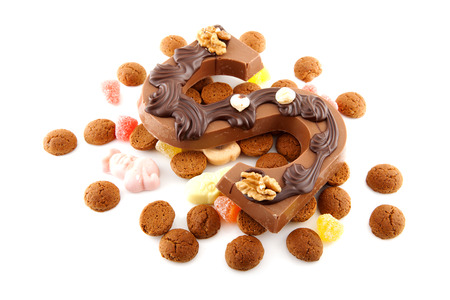 pepernoot: Decorated Chocolate letter S for Sinterklaas with ginger nuts, typical Dutch party in december, isolated on white background