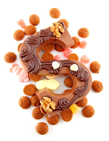 Decorated Chocolate letter S for Sinterklaas with ginger nuts, typical Dutch party in december, isolated on white background photo