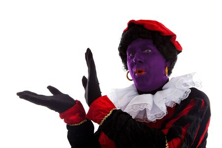 Purple piet ( black pete) jest on typical Dutch character part of a traditional event celebrating the birthday of Sinterklaas in december over white background photo
