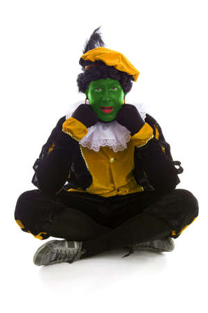 Annoyed Zwarte piet ( black pete) typical Dutch character part of a traditional event celebrating the birthday of Sinterklaas in december over white background photo