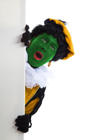 piet: groene Zwarte piet ( black pete) typical Dutch character part of a traditional event celebrating the birthday of Sinterklaas in december is holding a board over white background