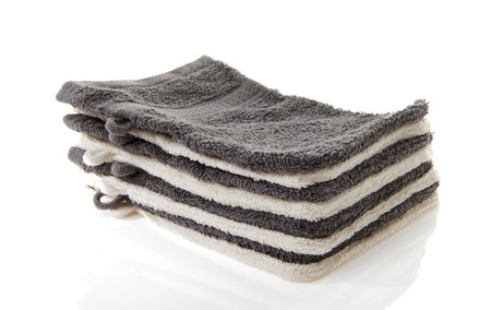 Pile of washcloths isolated on white background