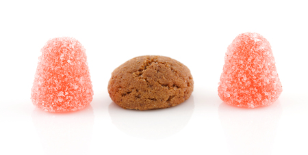 pepernoot: Pepernoot (ginger nuts) and tumtum candy over white background