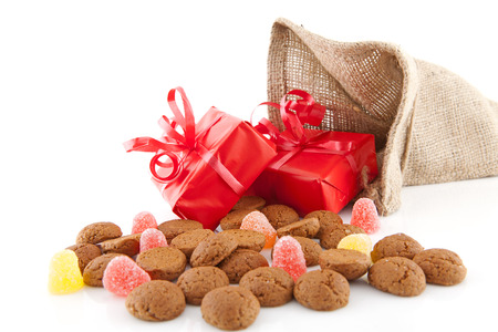Typical Dutch celebration: Sinterklaas with surprises in bag and ginger nuts, ready for the kids in december. Isolated on white background Standard-Bild