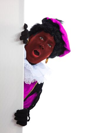 zwarte: Rode Zwarte piet ( black pete) typical Dutch character part of a traditional event celebrating the birthday of Sinterklaas in december is holding a board over white background