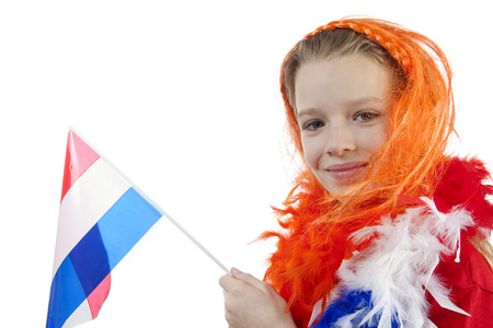Girl is posing in orange outfit for soccer game over white background photo