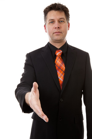 gratified: businessman is shaking your hand, isolated on white background Stock Photo