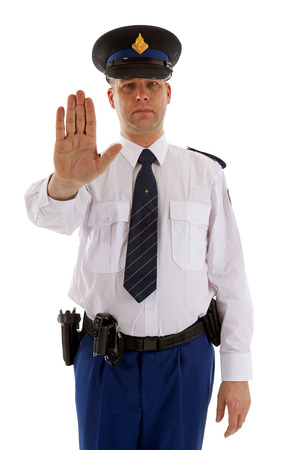 Dutch police officer is making stop sign with hand over white background