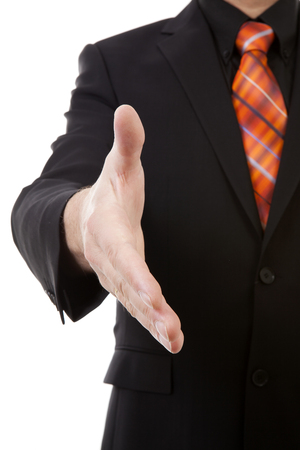 gratified: businessman is shaking your hand in closeup isolated on white background Stock Photo