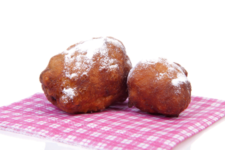 Two Dutch donut also known as oliebollen, traditional New Years eve food isolated on white background Stock Photo
