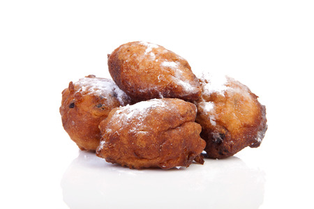 Four Dutch donut also known as oliebollen, traditional New Years eve food isolated on white background Stock Photo