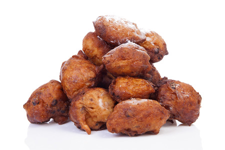 Pile of Dutch donut also known as oliebollen, traditional New Years eve food isolated on white background Stock Photo