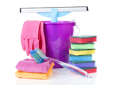 couple of colorful cleaning equipment over white background photo