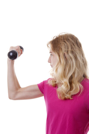 kilo: Girl is sporting with dumbbells over white background
