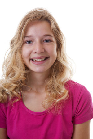 Teenager is smiling into camera over white background photo
