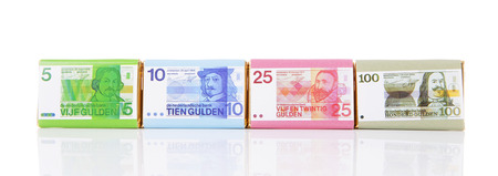 Chocolate money bars with old Dutch money over white