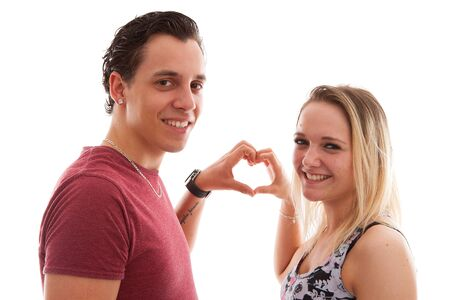 lovemaking: Young couple in lovemaking heart with hands over white background Stock Photo