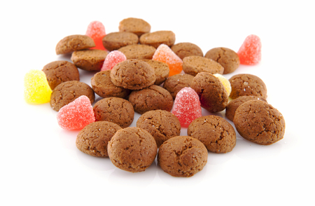ginger nuts: Typical dutch sweets: pepernoten (ginger nuts) for a celebration at 5 december in the Netherlands over white background Stock Photo