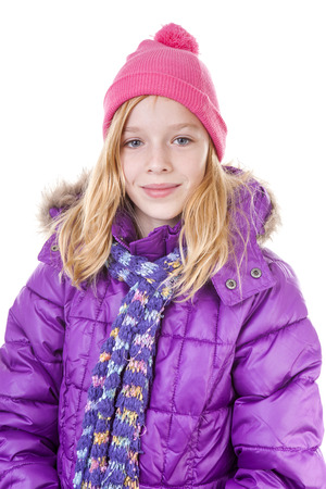 Teenage girl is posing in winter outfit over white backgroung photo
