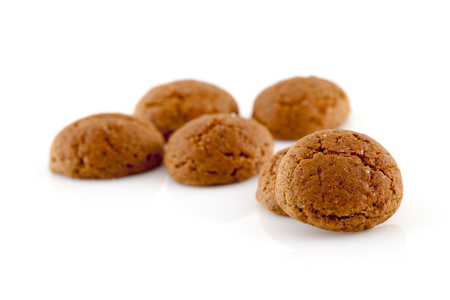 5 december: Typical dutch sweets: pepernoten (ginger nuts) for a celebration at 5 december in the Netherlands over white background Stock Photo