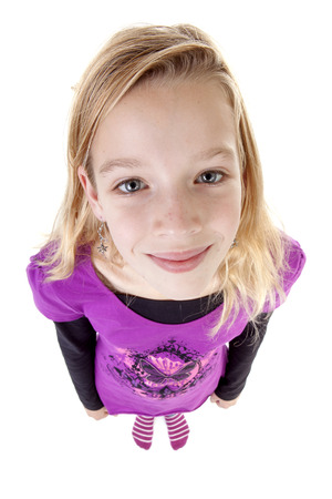 teenage girl in studio seen from above; big head little feet over white background