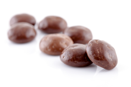 5 december: Typical dutch sweets: chocolate pepernoten (ginger nuts) for a celebration at 5 december in the Netherlands over white background Stock Photo